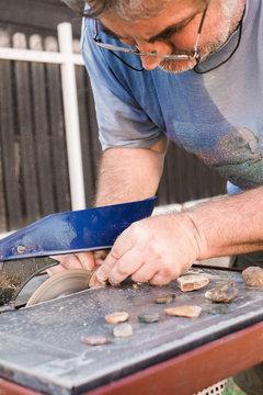 Senior Man Cutting Gemstones