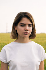 Beautiful teen girl looking pensively away