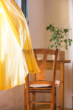 Yellow curtain waving in the room