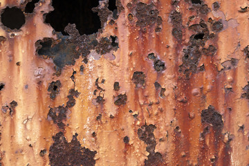 Rusty corrosion of metal due to prolonged exposure with open air