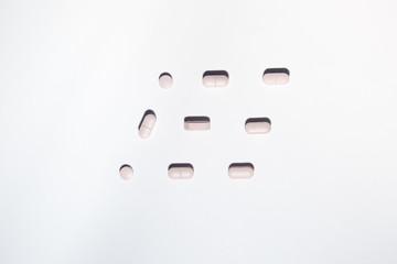 Pink pills shaping a rhombus