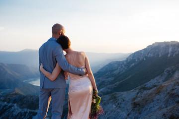 Wedding Couple  enyoing the sunset