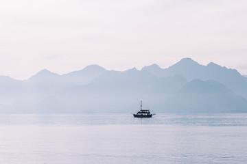 Little sailing ship on the sea