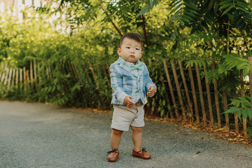 Korean Baby in front of Fence