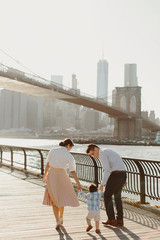 Young Family by Brooklyn Bridge