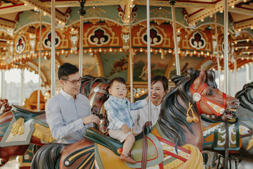 Young Family on Carousel