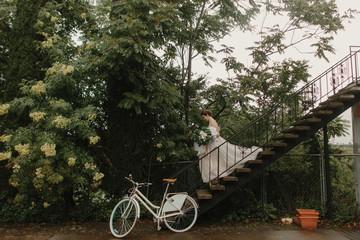 Bride Walking Down Step in front of Bike