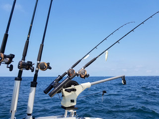 fishing rods and reels with lure on boat on Lake Michigan
