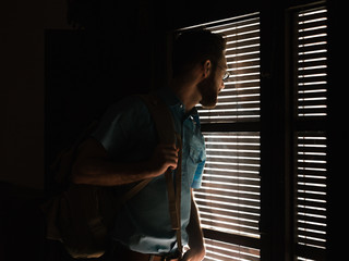 Man standing near window