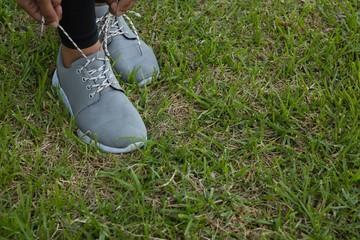 Athlete tying shoelace on field