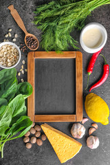 Chalkboard and ingredients for spinach dip on table