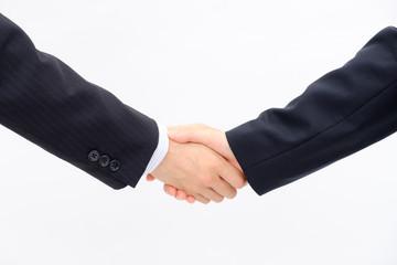 しっかりと握手するビジネスマン