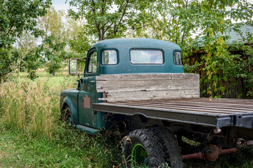 old pickup truck in field