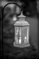 bw fancy latern hanging on hook at night