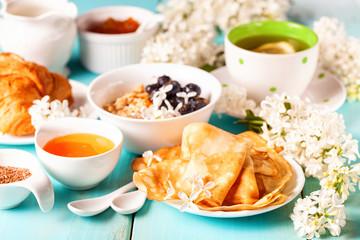 Breakfast - muesli, croissant, tea, jam, pancakes