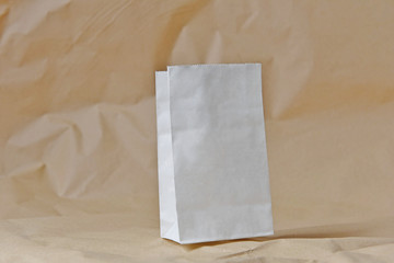 white bag paper on brown ground