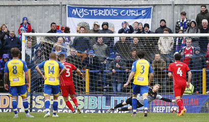Carlisle United's Danny Grainger scores their first goal