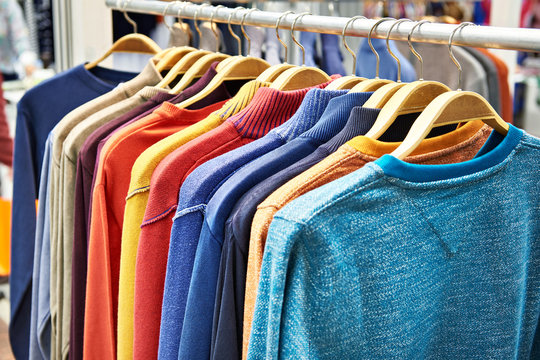 Sweaters on hanger in store