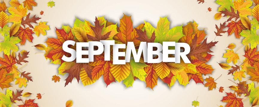 Herbstblätter mit dem Wort September