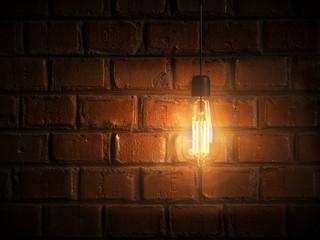 Edison LED Glühbirne strahlt warmes Licht aus vor einer Backsteinmauer