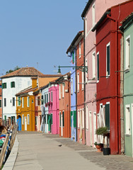 vivid colored houses on the island of Burano in Venice