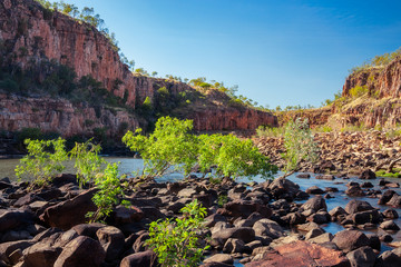Rocks and vegetation are blocking the river at Katherine Gorge, Northern Territory, Australia