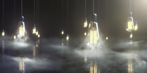 viele Edison Glühbirnen hängen im Raum und leuchten mit warmem Licht umgeben von geheimnisvollem Nebel