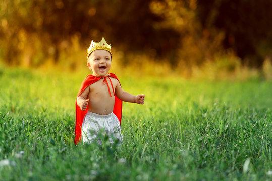 little boy child king laughs