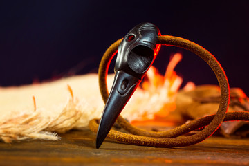 Closeup wooden raven skull as a magic amulet for witchcraft.