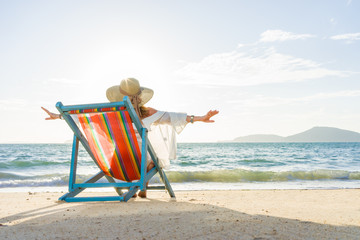 woman relaxing  on sun bed sofa lounge chair on holidays