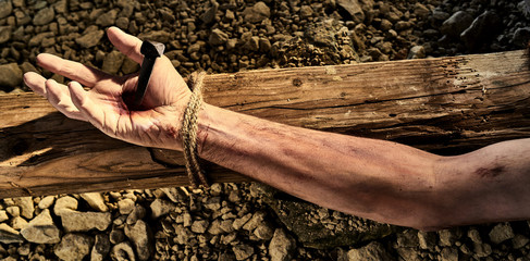 Arm of Christ nailed to a wooden cross