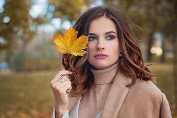 Autumn Woman with Autumn Leaves on Fall Nature Background