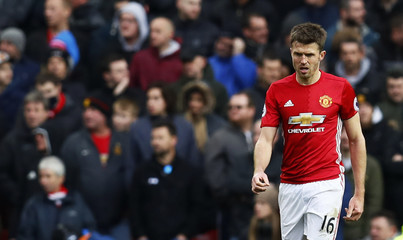 Manchester United's Michael Carrick looks dejected after Arsenal's Olivier Giroud scores their first goal
