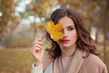 Perfect Autumn Woman Model with Brown Hair, with Fall Fashion Girl Outdoors