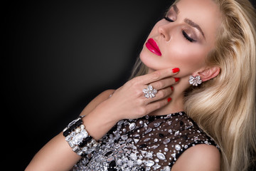 amazing beautiful young woman, model of elegant, luxury crystal evening dress, sexy blonde long hair advertises silver jewelry, earrings, dress with crystals, diamonds, jeweler