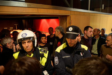 Anna Gabriel, spokeswoman for pro-Catalan independence party CUP, is blocked by municipal police as she tries to leave a meeting about a referendum for Catalan independence, in Vitoria