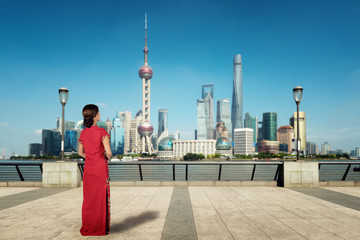 Asian young woman in Chinese traditional dress travel in Shanghai, China..