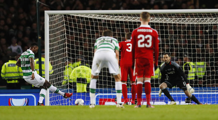 Celtic's Moussa Dembele scores their third goal from the penalty spot