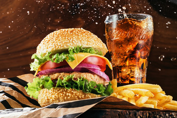 Studio photography of a hamburger with fries and a coke