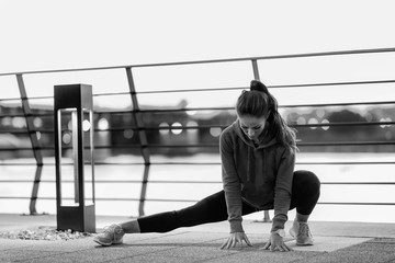 Woman streching after training Wall mural