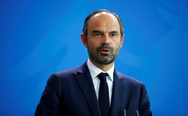 German Chancellor Angela Merkel and French Prime Minister Edouard Philippe attend a news conference in Berlin