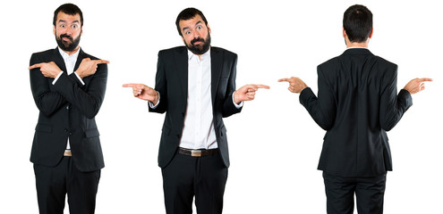 Set of Handsome businessman pointing to the laterals having doubts