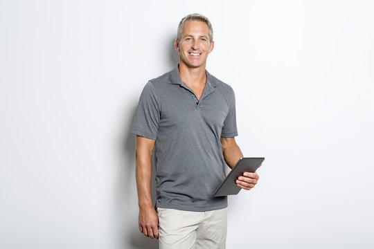 Studio fitness portrait isolated on grey background