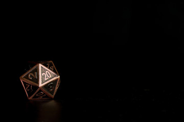 A polyhedral twenty sided dice used for role playing games such as Dungeons & Dragons.