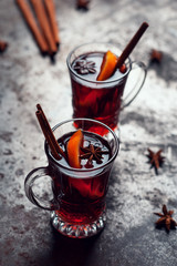Top view of Traditional winter mulled wine in vintage glass on metallic background, selective focus and toned image. Sangria on bar table. Celebration with spicy cocktail.