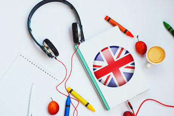 the book with british flag and headphones. concept of english learning through audio courses