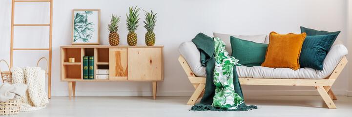 Pineapples on rustic cupboard