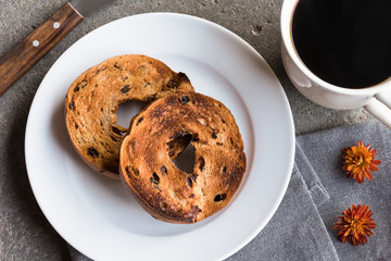 Toasted blueberry bagel and black coffee