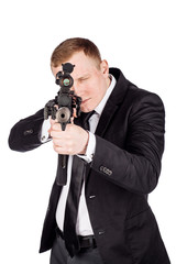Secret aghent or spy holds rifle with silincer in hand. Isolated on white background.