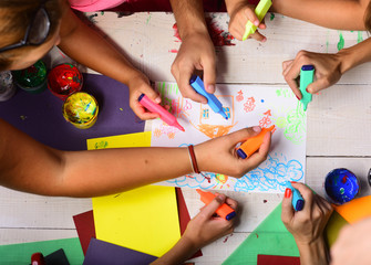 Creativity and art concept. Hands hold colorful markers